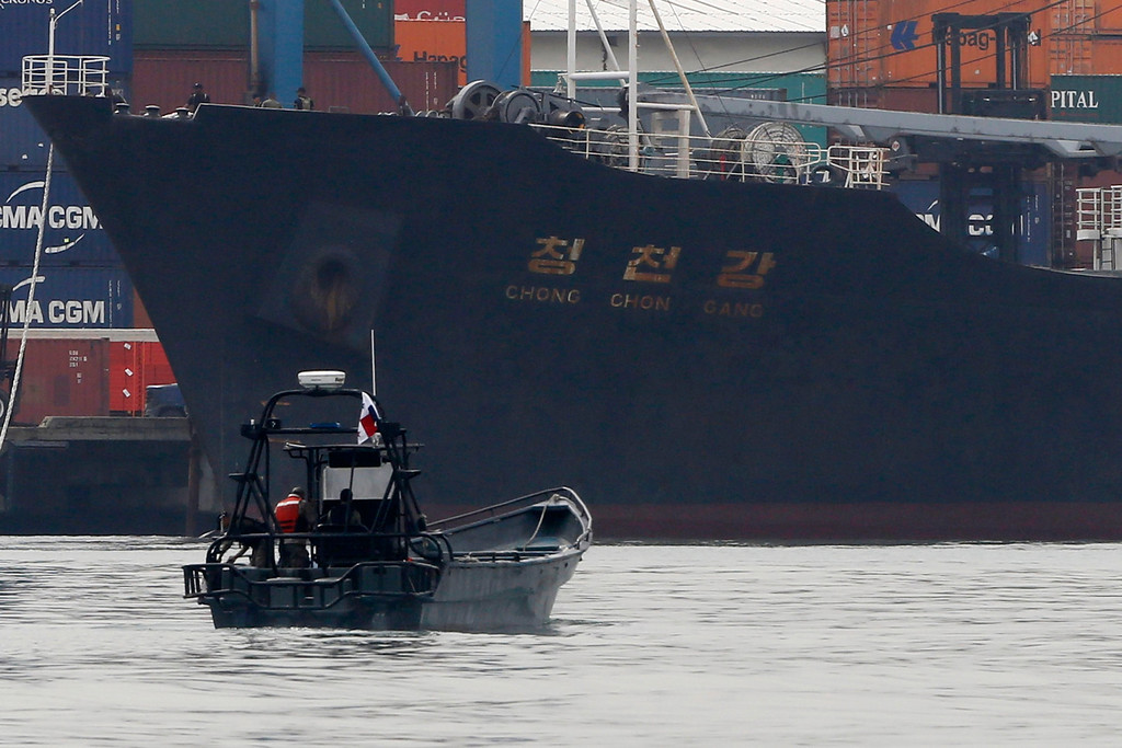 . North Korean container ship \'\'Chong Chon Gang\'\' docks at the Manzanillo International Container Terminal in Colon City July 16, 2013. Panama detained the North Korean-flagged ship from Cuba as it headed to the Panama Canal and said it was hiding weapons in brown sugar containers, sparking a standoff in which the ship\'s captain attempted to commit suicide. REUTERS/Carlos Jasso
