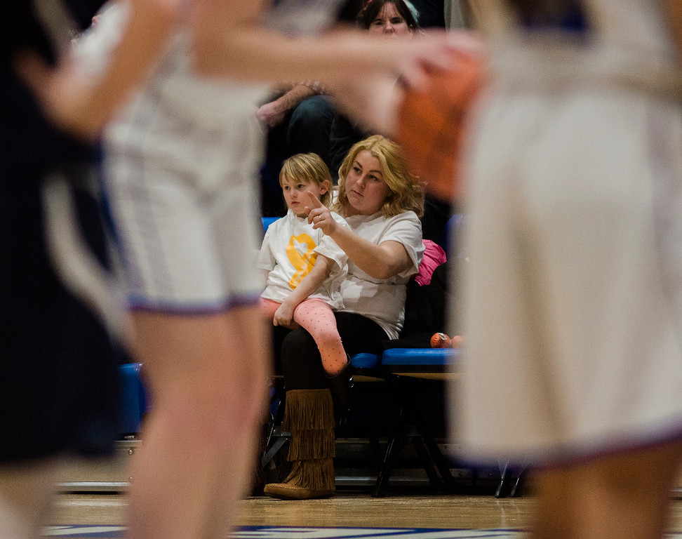 """. Jen Cotoni and daughter Kaylee, 5, watch the Lunenburg High \""""Baskets for Brandon\"""" fundraiser on Friday evening. Funds raised during the event went towards the Cotoni family. Brandon Cotoni, a first grader at the Lunenburg Primary School, was diagnosed with neuroblastoma in November and is currently undergoing treatment. SENTINEL & ENTERPRISE / Ashley Green"""