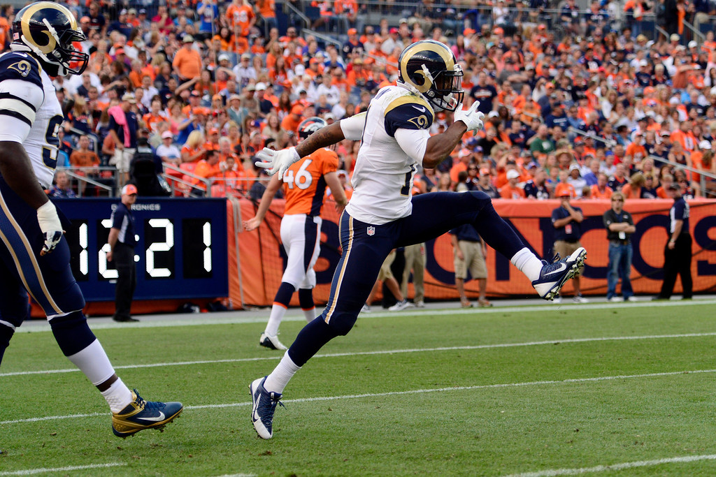 . DENVER, CO - AUGUST 24: Tavon Austin (11) of the St. Louis Rams celebrates returning a punt to the Broncos\' one-yard line during the first half of action of an NFL preseason game at Sports Authority Field at Mile High on August 24, 2013. This is the third game of the preseason for the Broncos. (Photo by AAron Ontiveroz/The Denver Post)