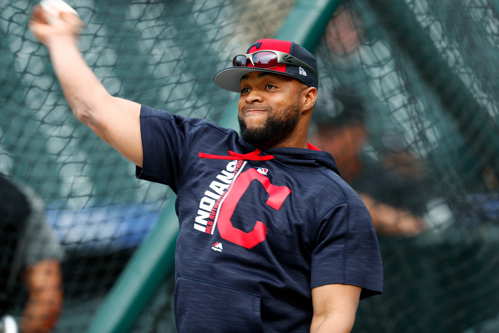 . Cleveland Indians first baseman Carlos Santana warms up as the team practices before facing the Colorado Rockies on Tuesday, June 6, 2017, in Denver.(AP Photo/David Zalubowski)