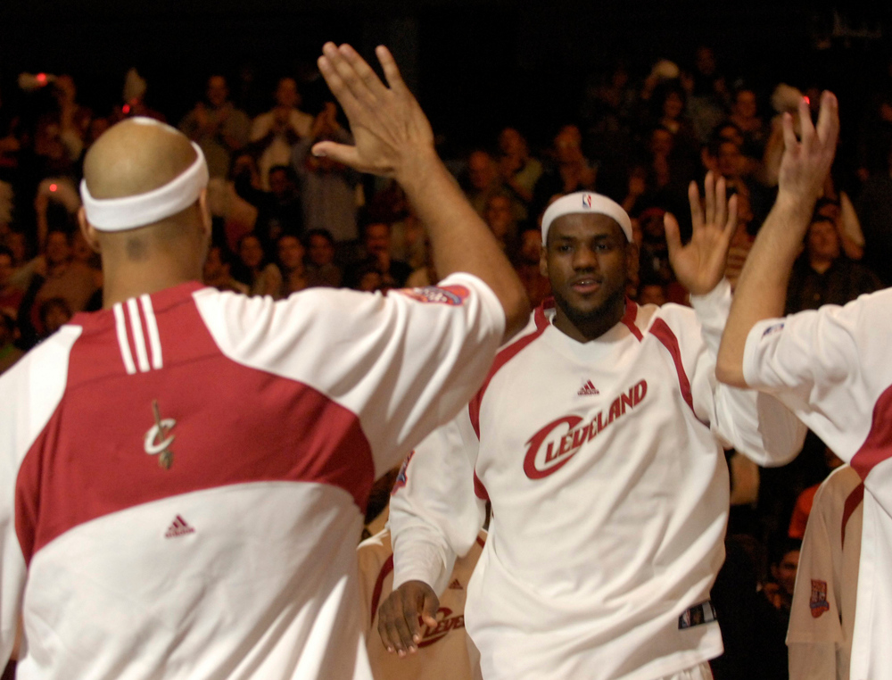 . Lebron James greet his teammates before the start of the Cavaliers opener against the Wizards Wednesday at Quicken Loan Arena.