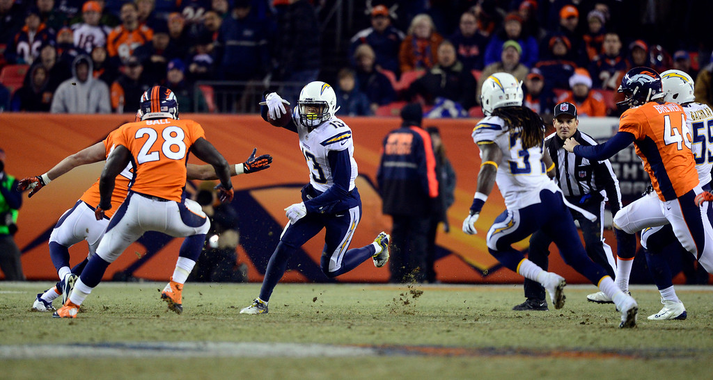 . San Diego Chargers wide receiver Keenan Allen (13) returns a punt in the first half.  The Denver Broncos vs. the San Diego Chargers at Sports Authority Field at Mile High in Denver on December 12, 2013. (Photo by AAron Ontiveroz/The Denver Post)
