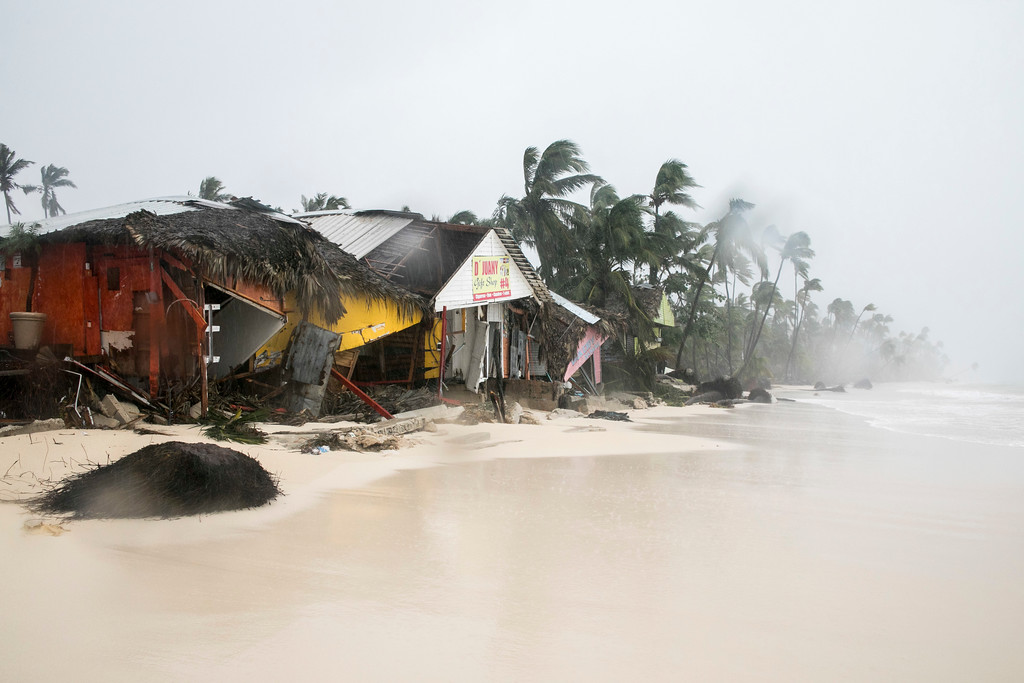 . A gift shop damaged in the crossing of Hurricane Maria is shown on Cofrecito Beach, Bavaro, Dominican Republic, Thursday, Sept. 21, 2017.  Rain from the storm will continue in the Dominican Republic for the next two days according to meteorologists. (AP Photo/Tatiana Fernandez)