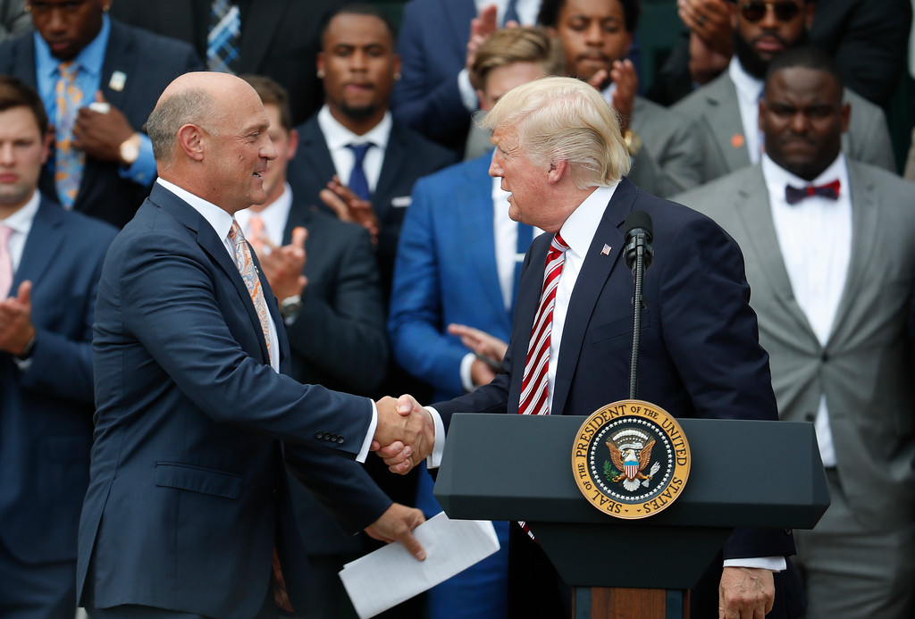 . President Donald Trump shakes hands with Clemson University President James P. Clements as he welcomed the 2016 NCAA Football National Champions Clemson University Tigers, Monday, June 12, 2017, during a ceremony on the South Lawn of the White House in Washington. (AP Photo/Pablo Martinez Monsivais)