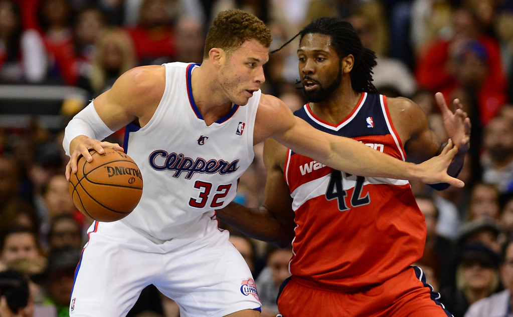 . Blake Griffin of the Los Angeles Clippers controls the ball under pressure from Nene of the Washington Wizards during their NBA game in Los Angeles on January 19, 2013.  AFP PHOTO / Frederic J. BROWNFREDERIC J. BROWN/AFP/Getty Images