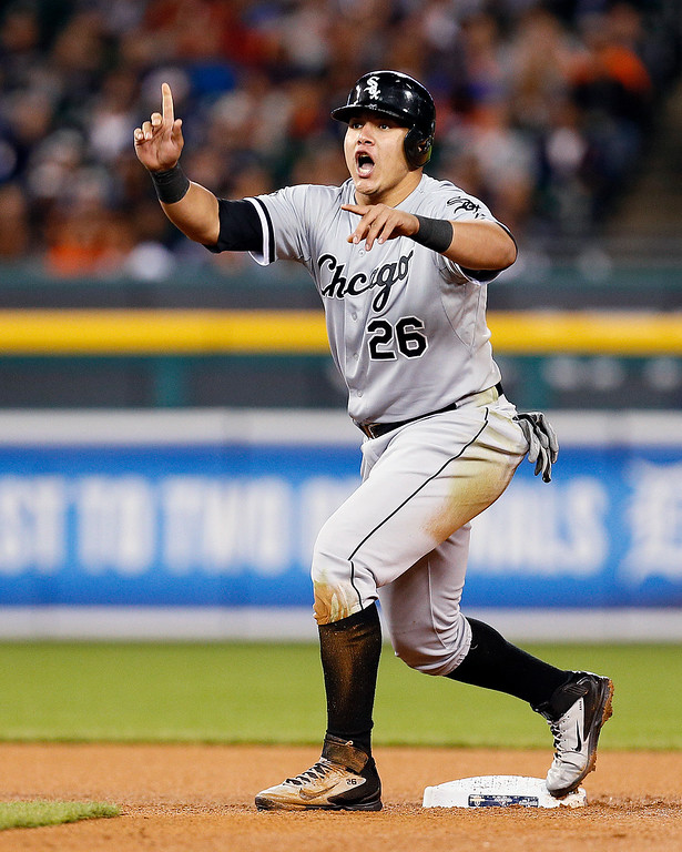 . Chicago White Sox\'s Avisail Garcia signals the bench about being called out attempting to steal second base against the Detroit Tigers in the sixth inning of a baseball game in Detroit Monday, Sept. 22, 2014. Garcia was ruled out (AP Photo/Paul Sancya)
