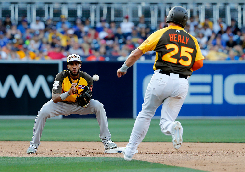 . U.S. Team\'s Ryon Healy (25), of the Oakland Athletics, is forced out by Dilson Herrera, of the New York Mets, after Dominic Smith,of the New York Mets, hit into a double play during the eighth inning of the All-Star Futures baseball game, Sunday, July 10, 2016, in San Diego. (AP Photo/Lenny Ignelzi)