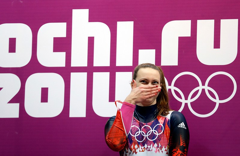 . Ekaterina Baturina of Russia smiles after her final run during the women\'s singles luge competition at the 2014 Winter Olympics, Tuesday, Feb. 11, 2014, in Krasnaya Polyana, Russia. (AP Photo/Natacha Pisarenko)