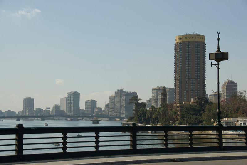 View of skyline and Nile River bank from bridge - Cairo, Egypt