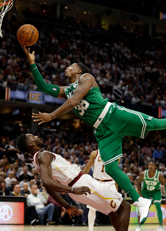 . Boston Celtics\' Marcus Smart, top, fouls Cleveland Cavaliers\' Jeff Green in the first half of an NBA basketball game, Tuesday, Oct. 17, 2017, in Cleveland. (AP Photo/Tony Dejak)
