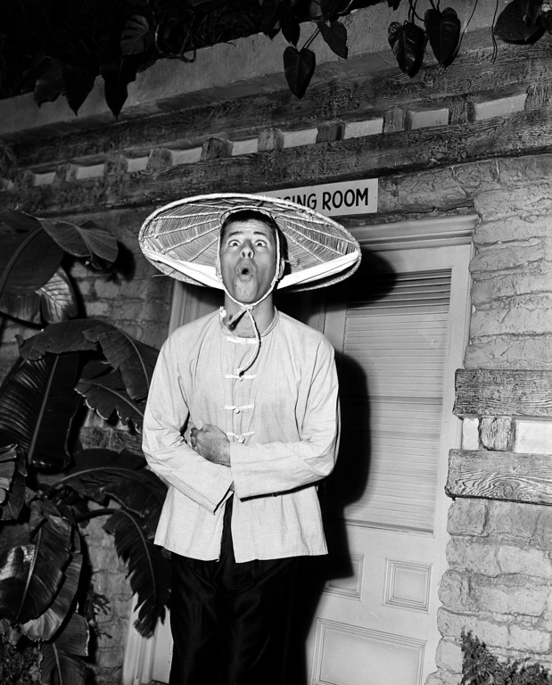". Actor-comedian Jerry Lewis, dressed for his role in ""Sailor Beware,\"" entertains on the movie set in Hollywood, Ca., 1951.  (AP Photo)"
