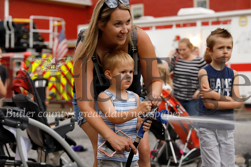 Waylon Schoppe, 3,  works on his fireman skills, with the help of his mom Katie Schoppe. Seb Foltz/Butler Eagle