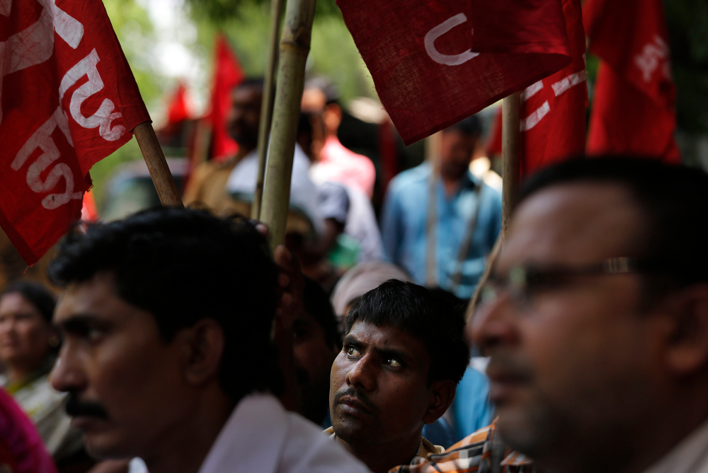 . Indian workers and activists participate in a rally by Indian Federation of Trade Unions to mark May Day In New Delhi, India ,Thursday, May 1, 2014. The workers demanded abolition of contract labor, safety for women and strict implementation of labor laws, according to a press release. (AP Photo/Manish Swarup)
