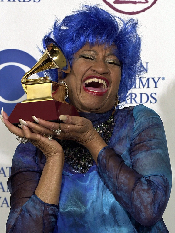 . Salsa diva Celia Cruz shows off her award for best salsa  performance at the first annual Latin Grammy Awards in Los Angeles, Wednesday, Sept. 13, 2000. (AP Photo/Mark J. Terrill)