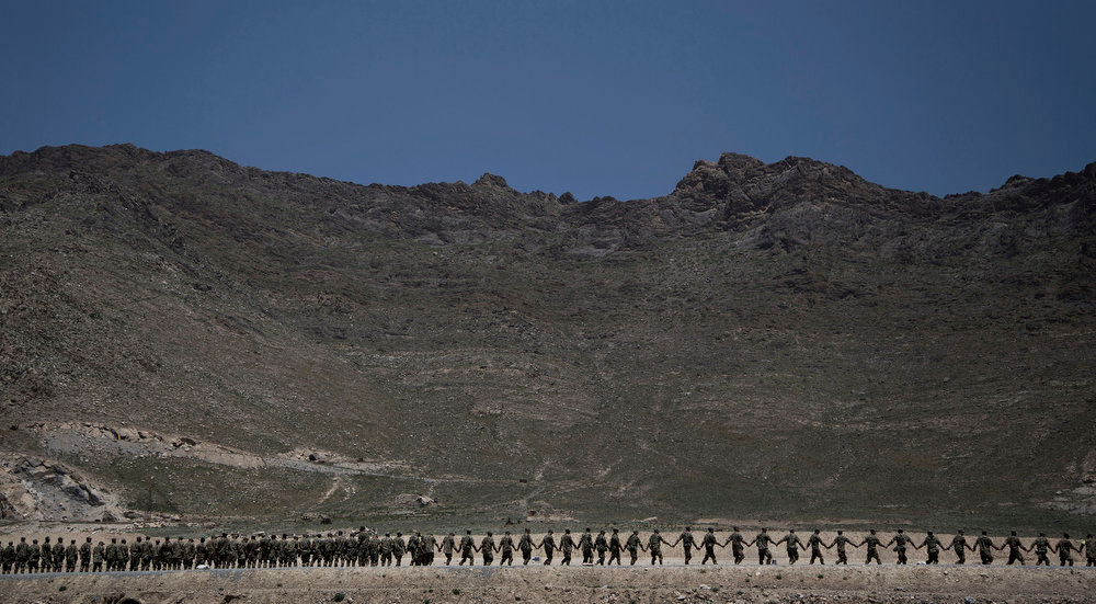 . Afghan Army soldiers line up at a training facility in the outskirts of Kabul, Afghanistan on Wednesday, May 8, 2013. In roughly 90 percent of the country, Afghan police and soldiers are taking the fight to the Taliban alone, a first in 12 years of war. U.S. and NATO soldiers have slipped quietly into the background, taking on the role of advisor and providing backup when needed.  (AP Photo/Anja Niedringhaus)