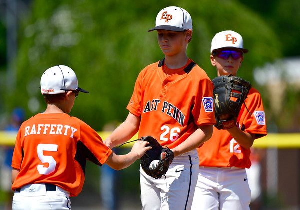 8/4/2019 Mike Orazzi | Staff East Pennsboro Little League's Brody Rafferty (5), Chase Deibler (26) and Steel Bayer (12) during their opening round game of the Little League Mid-Atlantic regional Baseball Tournament in Bristol.