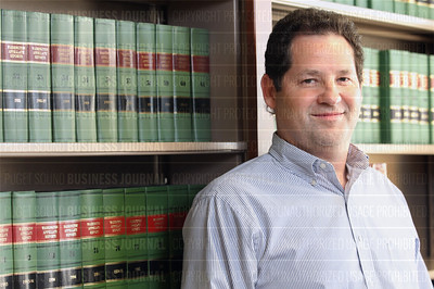 Jesse Wing, a fair housing attorney, is pictured in the law library of his firm, MacDonald Hoague and Bayless in Seattle, Washington