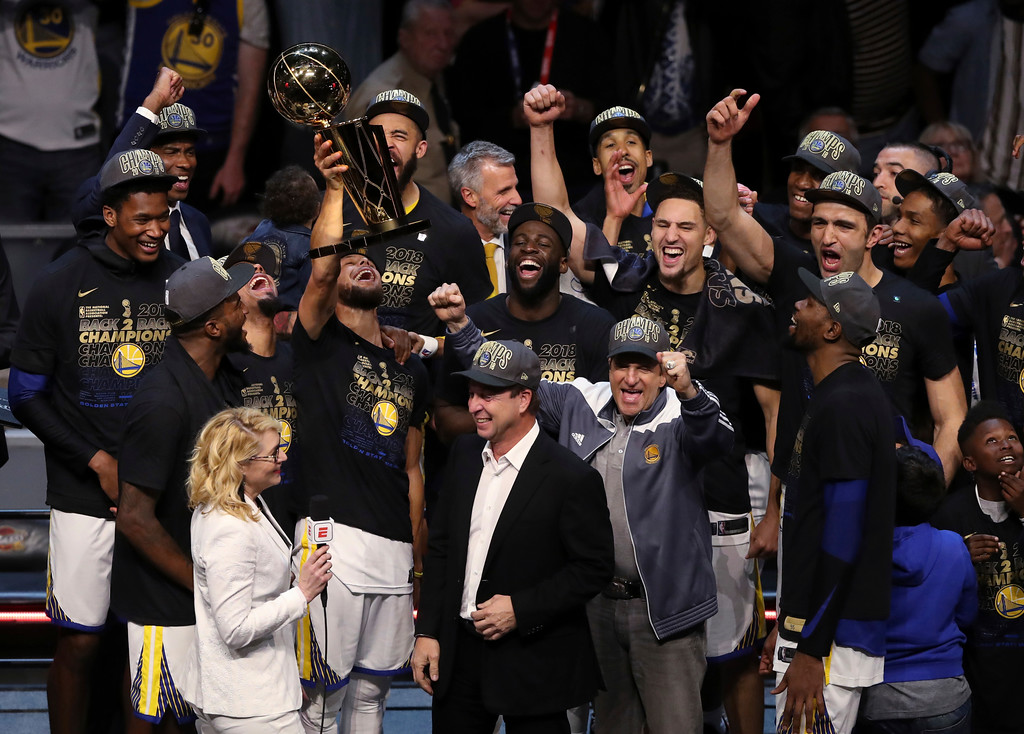 . The Golden State Warriors celebrate after defeating the Cleveland Cavaliers 108-85 in Game 4 of basketball\'s NBA Finals to win the NBA championship, Friday, June 8, 2018, in Cleveland. (AP Photo/Carlos Osorio)