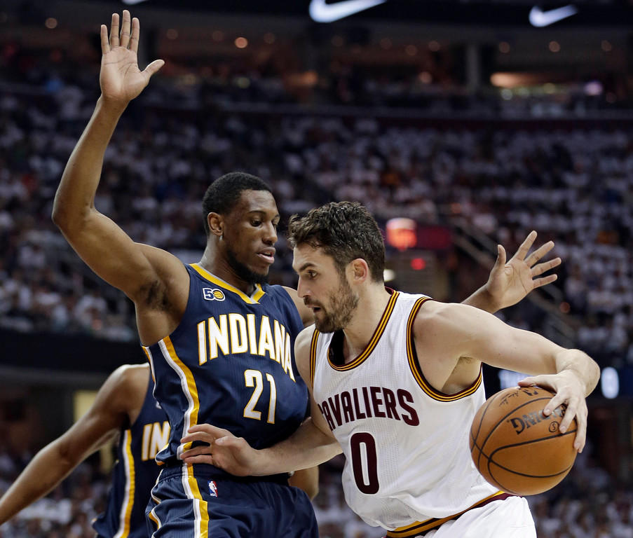 . Cleveland Cavaliers\' Kevin Love (0) drives past Indiana Pacers\' Thaddeus Young (21) in the first half in Game 1 of a first-round NBA basketball playoff series, Saturday, April 15, 2017, in Cleveland. (AP Photo/Tony Dejak)