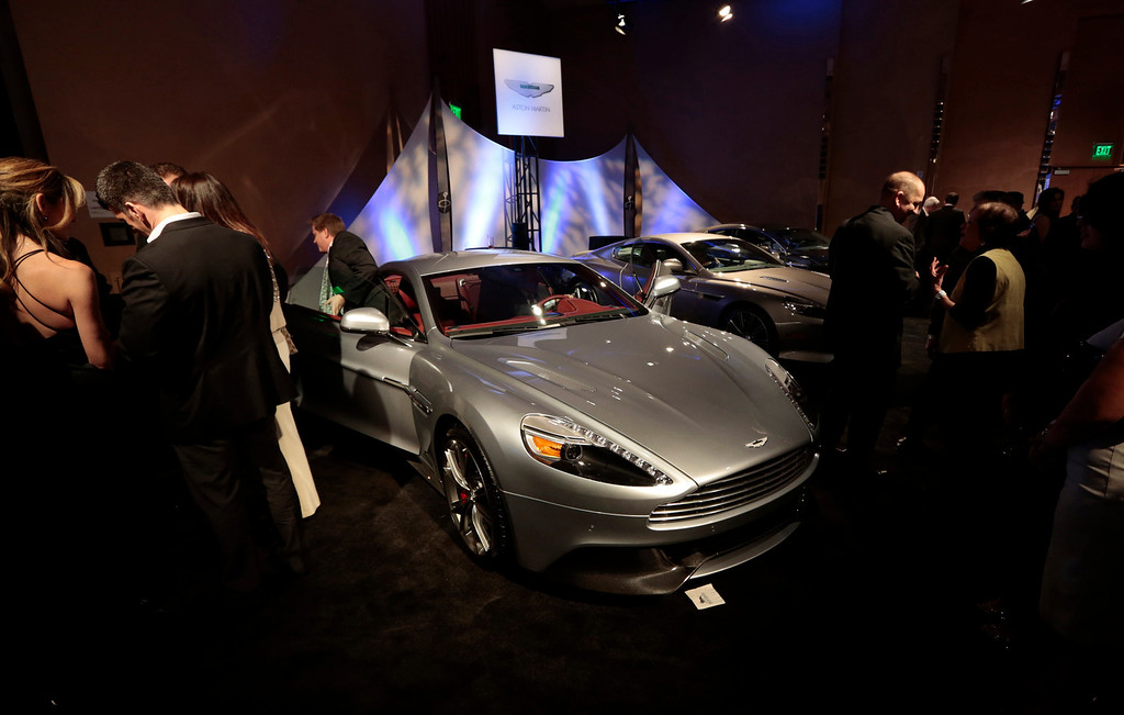 . A man gets out of an Aston Martin Vanquish at The Gallery in the MGM Grand Detroit ahead of the 2013 North American International Auto Show (NAIAS) in Detroit, Michigan, U.S., on Saturday, Jan. 12, 2013. The Detroit auto show runs through Jan. 27 and will display over 500 vehicles, representing the most innovative designs in the world. Photographer: Jeff Kowalsky/Bloomberg