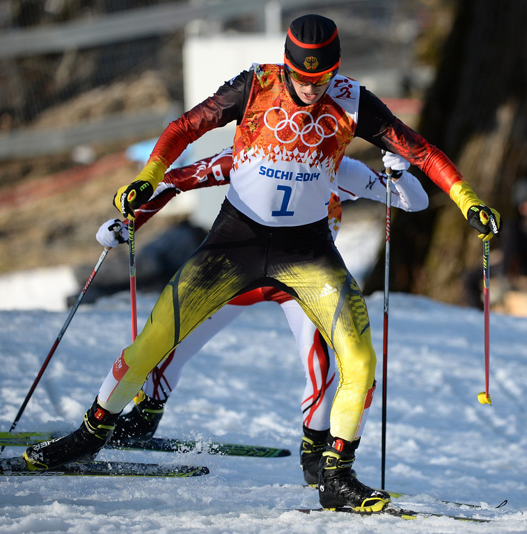 . Gold medalist Germany\'s Eric Frenzel (1) and silver medalsit Japan\'s Akito Watabe (2 behind) compete in the Nordic Combined Individual NH / 10 km Cross-Country at the RusSki Gorki Jumping Center during the Sochi Winter Olympics on February 12, 2014 in Rosa Khutor near Sochi.  AFP PHOTO / PETER PARKS/AFP/Getty Images