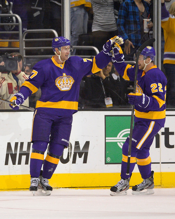 . Los Angeles Kings center Jeff Carter, left, celebrates his goal with center Trevor Lewis during the first period of their NHL hockey game against the Colorado Avalanche, Saturday, Feb. 23, 2013, in Los Angeles. (AP Photo/Mark J. Terrill)