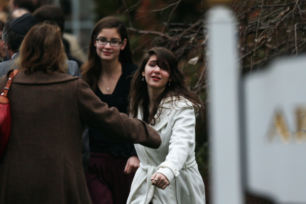 Description of . Three women greet each other as they arrive for the funeral services of six year-old Noah Pozner, who was  killed in the shooting massacre in Newtown, CT, at Abraham L. Green and Son Funeral Home on December 17, 2012 in Fairfield, Connecticut. Today is the first day of funerals for some of the twenty children and seven adults who were killed by 20-year-old Adam Lanza on December 14, 2012.  (Photo by Spencer Platt/Getty Images)