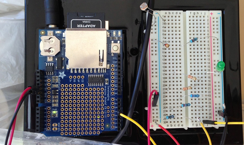 The measuring system consists of a data logger built with an Arduino, with a realtime clock and SD writer.  The clock keeps time, even if the Arduino gets switched off, while the system measures humidity and temperature inside the propagation chamber and logs raw data to an SD card (formatted in FAT16), in comma-separated text.  The data file can then be read easily with Microsoft Excel.