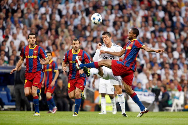Keita defending before Ronaldo, UEFA Champions League Semifinals game between Real Madrid and FC Barcelona, Bernabeu Stadiumn, Madrid, Spain
