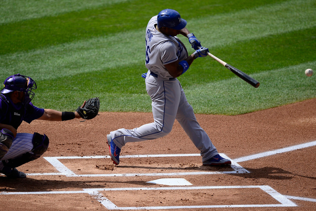 . Yasiel Puig (66) of the Los Angeles Dodgers rips a base hit off of Chad Bettis (35) of the Colorado Rockies during the action in Denver on Monday, September 2, 2013. The Colorado Rockies hosted the Los Angeles Dodgers at Coors Field.   (Photo by AAron Ontiveroz/The Denver Post)