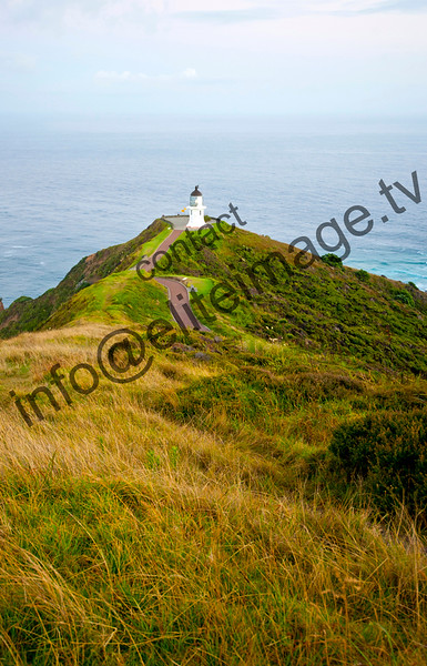the view down to the Cape Reinga Lighthouse at dawn
