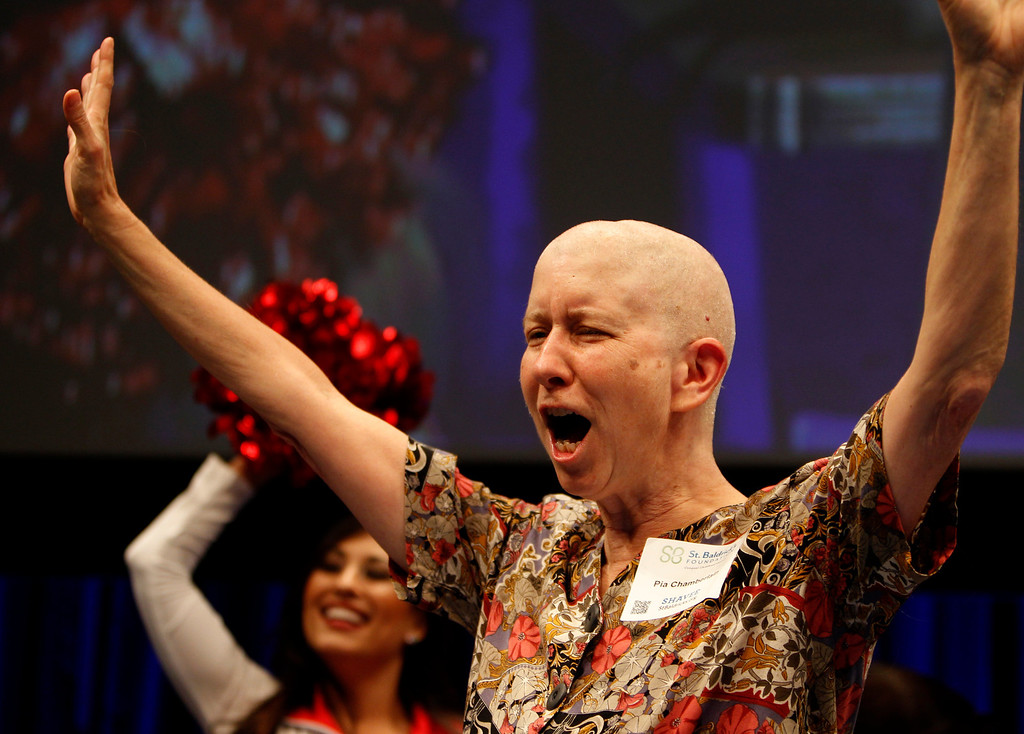 . Pia Chamberlain cheers after she had her head shaved for the St. Baldrick\'s Day head shaving event in support of research for pediatric cancer sponsored by the St. Baldrick\'s Foundation in the NetApp gymnasium at NetApp in Sunnyvale, Calif., on Thursday, March 14, 2013.  (Nhat V. Meyer/Staff)