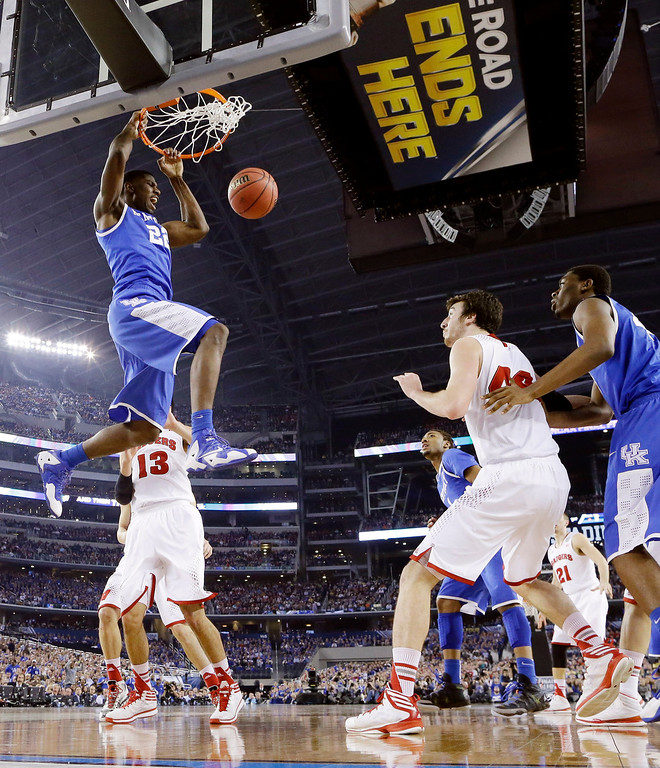 . Kentucky forward Alex Poythress (22) dunks against Wisconsin during the first half of the NCAA Final Four tournament college basketball semifinal game Saturday, April 5, 2014, in Arlington, Texas. (AP Photo/Eric Gay)