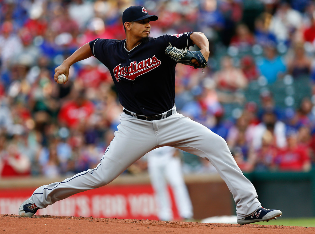 . Cleveland Indians starting pitcher Carlos Carrasco (59) throws to the Texas Rangers during the first inning of a baseball game, Saturday, July 21, 2018, in Arlington, Texas. (AP Photo/Jim Cowsert)