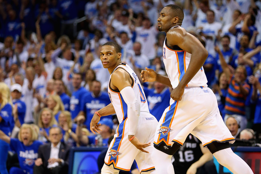 . OKLAHOMA CITY, OK - MAY 27:  Russell Westbrook #0 of the Oklahoma City Thunder reacts after a basket in the third quarter against the San Antonio Spurs during Game Four of the Western Conference Finals of the 2014 NBA Playoffs at Chesapeake Energy Arena on May 27, 2014 in Oklahoma City, Oklahoma. (Photo by Ronald Martinez/Getty Images)