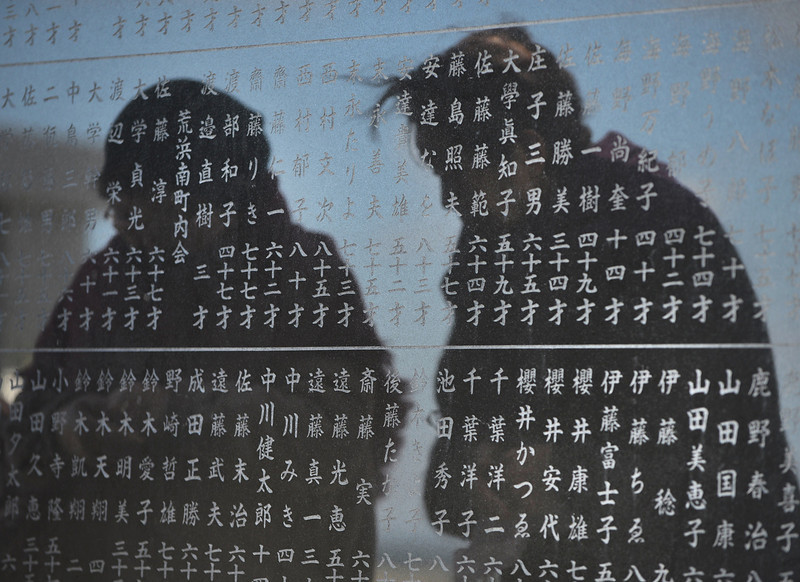 . Two elderly women are reflected on a monument on which names of tsunami victim from the district are carved in Arahama district in Sendai, Miyagi Prefecture, on March 11, 2013. Japan on March 11 marked the second anniversary of a ferocious tsunami that claimed nearly 19,000 lives and sparked the worst nuclear accident in a generation. TORU YAMANAKA/AFP/Getty Images