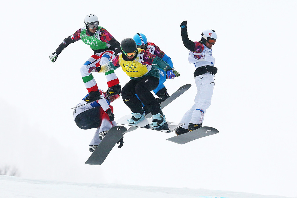 . Cameron Bolton of Australia (yellow bib) leads the field in the Men\'s Snowboard Cross 1/8 Finals on day eleven of the 2014 Winter Olympics at Rosa Khutor Extreme Park on February 18, 2014 in Sochi, Russia.  (Photo by Cameron Spencer/Getty Images)
