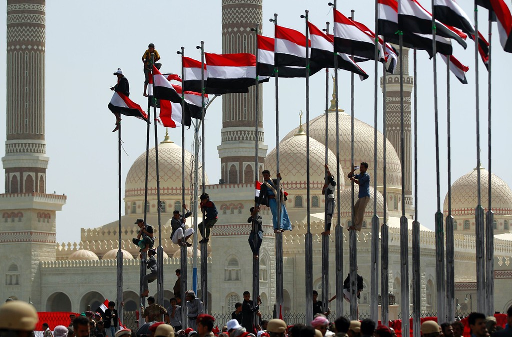 . Yemenis take part in celebrations marking the 26th anniversary of Yemen\'s 1990 reunification in the capital Sanaa on May 22, 2016. MOHAMMED HUWAIS/AFP/Getty Images