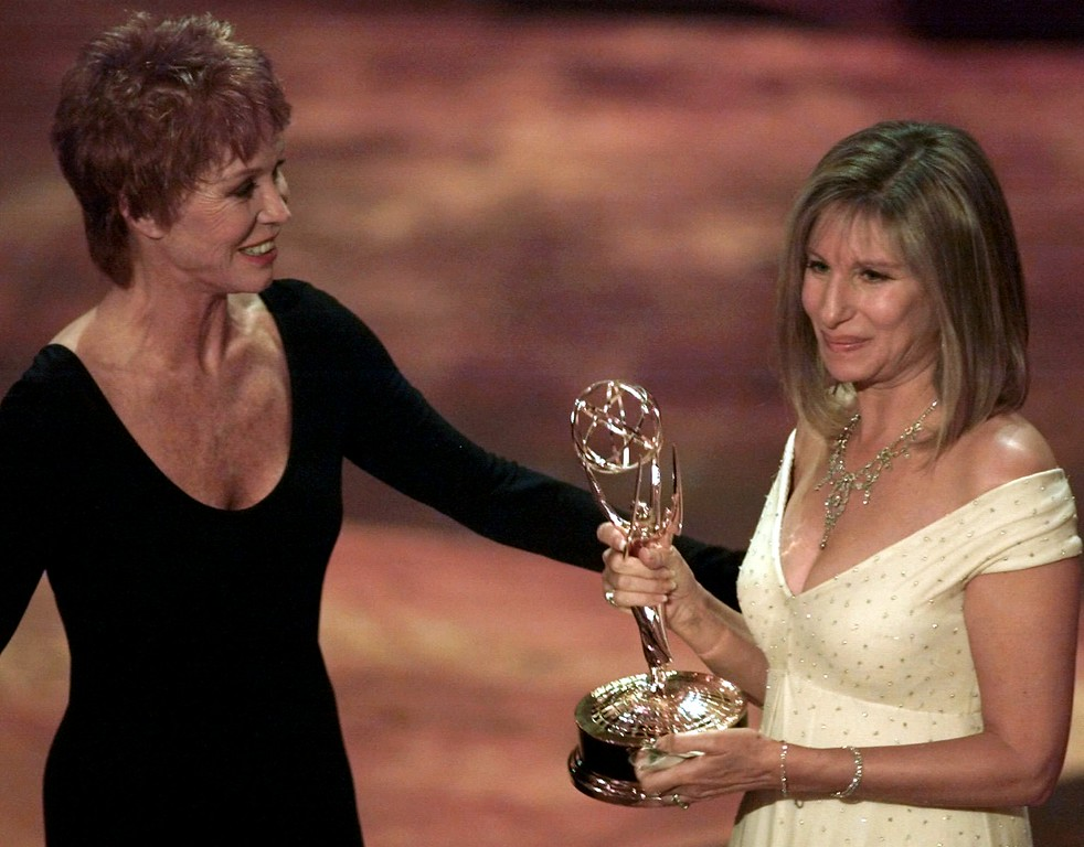 ". Mary Tyler Moore, left, presents Barbara Streisand with the Emmy for Outstanding Individual Performance in a Variety or Music Program for Streisand\'s appearance in ""Barbra Streisand The Concert\"" during the 47th annual Emmy Awards, Sunday, Sept. 10, 1995,in Pasadena, Calif. (AP Photo/Eric Draper)"
