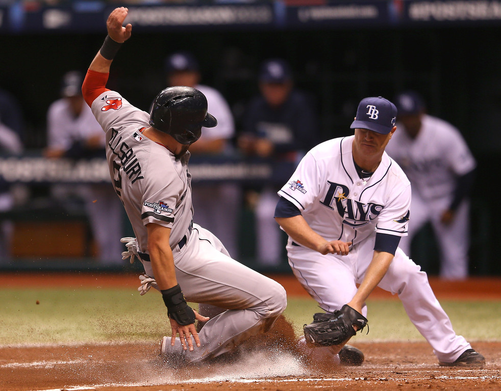 . Jacoby Ellsbury #2 of the Boston Red Sox scores on a wild pitch in the fourth inning as Alex Cobb #53 of the Tampa Bay Rays tries to cover home plate during Game Three of the American League Division Series at Tropicana Field on October 7, 2013 in St Petersburg, Florida.  (Photo by Mike Ehrmann/Getty Images)