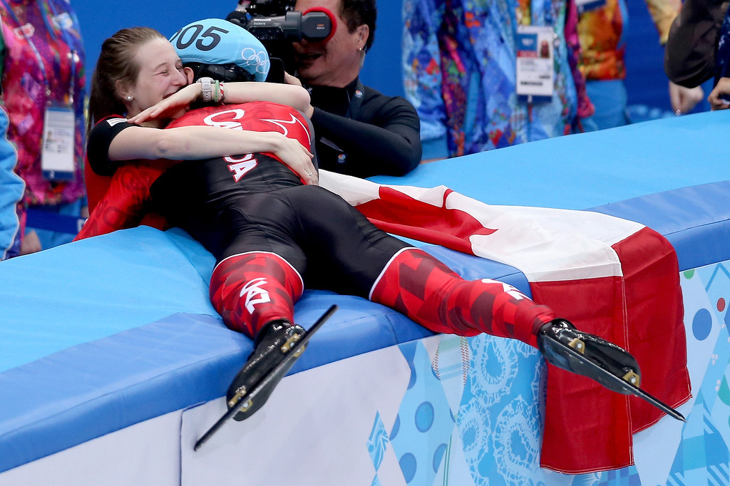 . Gold medalist Charles Hamelin of Canada celebrates with Marianne St-Gelais after wiining the Short Track Men\'s 1500m Final on day 3 of the Sochi 2014 Winter Olympics at Iceberg Skating Palace on February 10, 2014 in Sochi, Russia.  (Photo by Matthew Stockman/Getty Images)