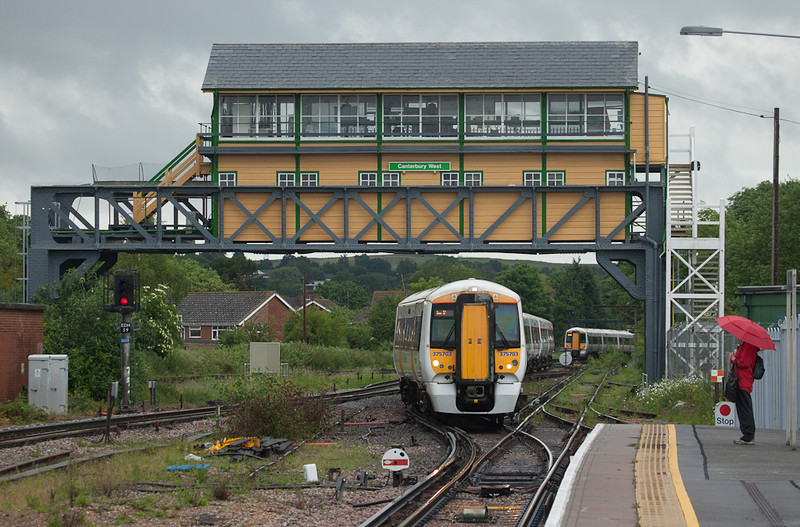 Southeastern Trains 375 703 passes under the signalbox in Canterbury West, Kent.