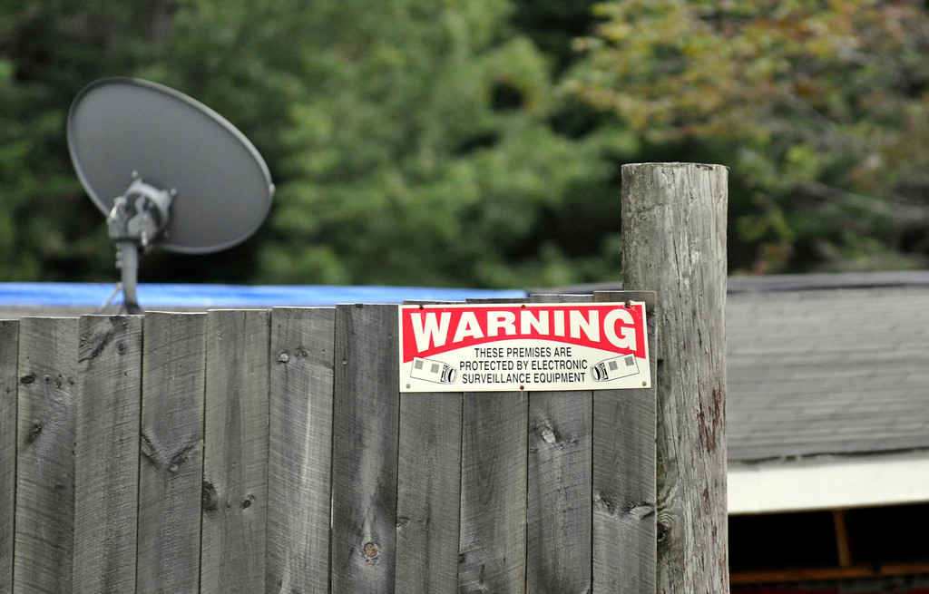. A sign at the Peru compound of Adam Lee Hall indicates electronic surveillance.  Thursday Sept 15, 2011 (GARVER)