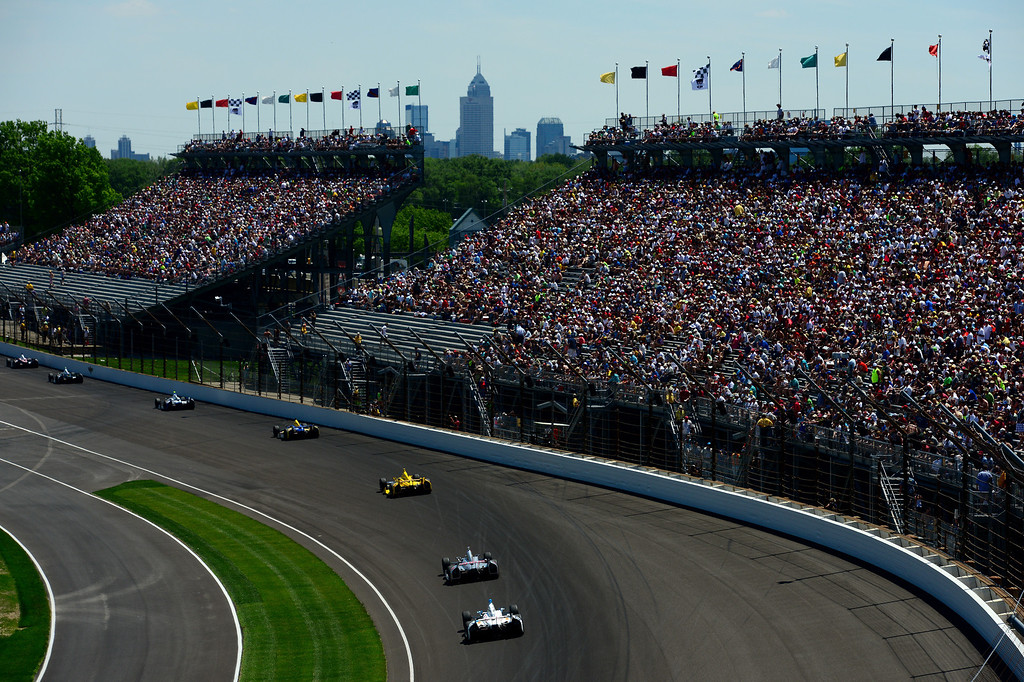. Cars race during the 98th running of the Indianapolis 500 at Indianapolis Motorspeedway on May 25, 2014 in Indianapolis, Indiana.  (Photo by Robert Laberge/Getty Images)