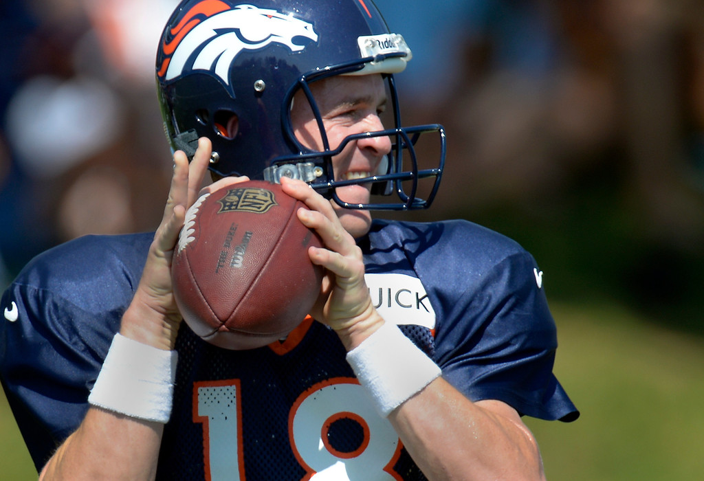 . Denver Broncos quarterback Peyton Manning (18) drops back to pass during drills at practice August 20, 2013 at Dove Valley (Photo by John Leyba/The Denver Post)