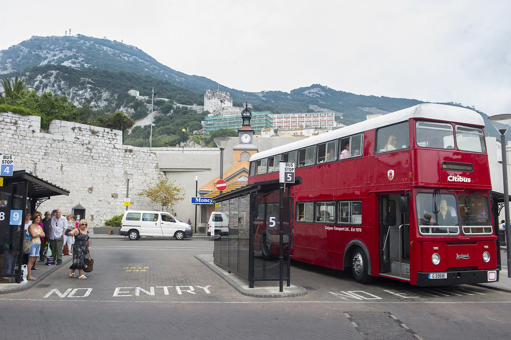 . Tourists ride a bus on Vistas de la Plaza del Reloj in Gibraltar on August 13, 2013. This rock of seven square kilometers enclosed in the coast of Andalusia, off the tip of southern Spain, is reminiscent of England: the red phone booths, mailboxes Royal Mail, the lampposts decorated with flowers, and double decker buses.   MARCOS MORENO/AFP/Getty Images