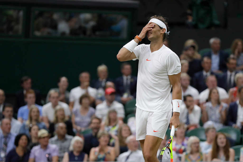 . Rafael Nadal of Spain reacts after losing a point during his men\'s singles semifinals match against Serbia\'s Novak Djokovic, at the Wimbledon Tennis Championships, in London, Friday July 13, 2018.(AP Photo/Kirsty Wigglesworth)