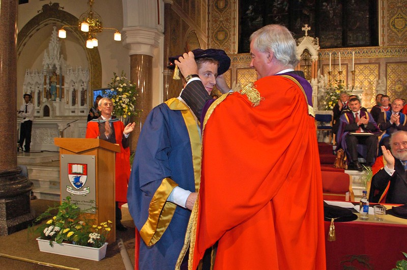 Provision 251006 Professor Kieran Byrne (Director WIT) places the hat on Dr Wayne Cummins from New Ross in Wexford during the graduation ceremony in WIT on Wednesday. PIC Bernie Keating/Provision