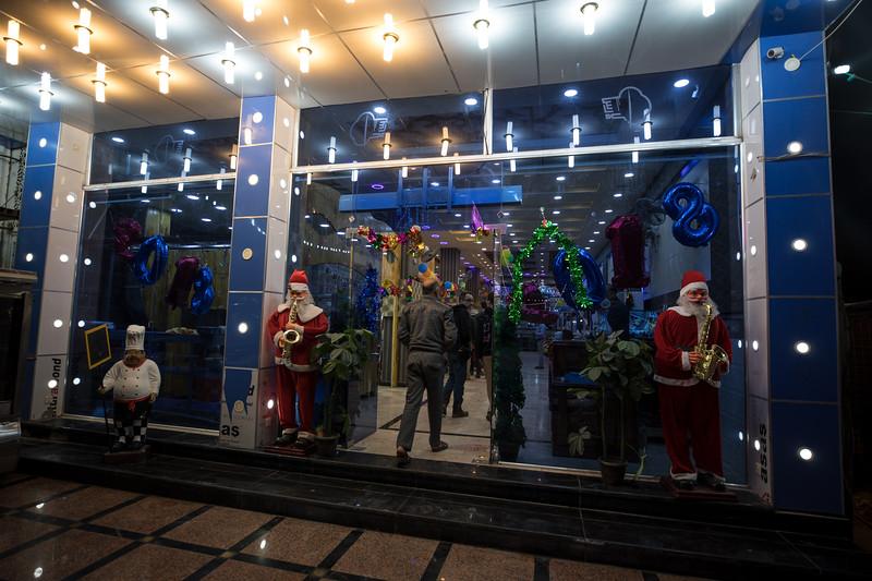 Robotic Santa's outside a restaurant in the city of Nasiriyah.