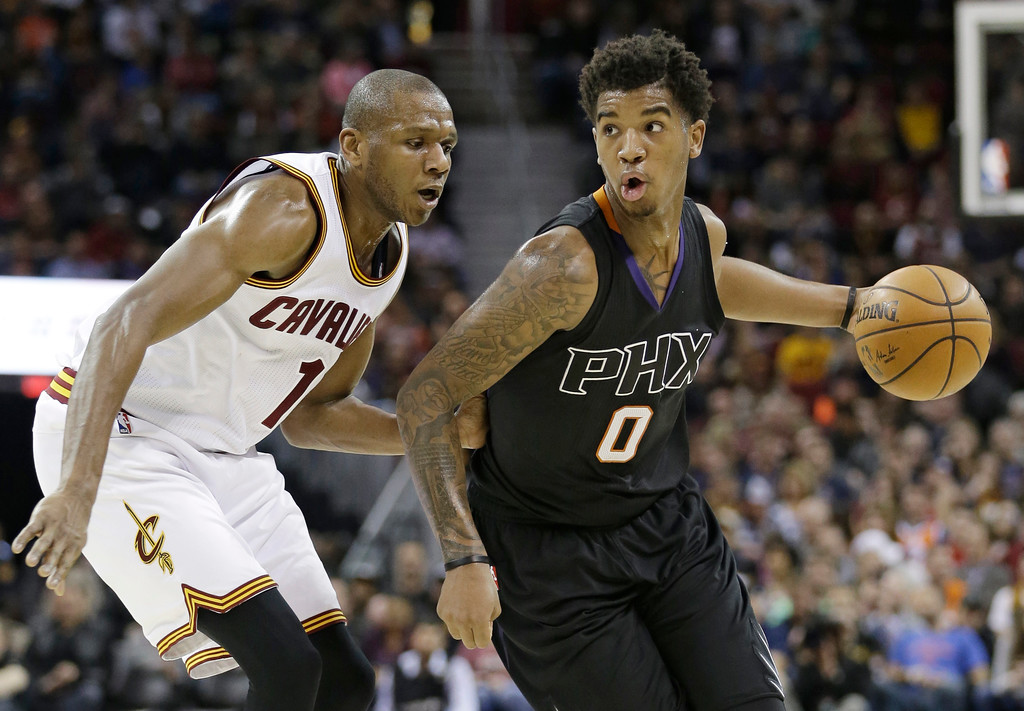 . Phoenix Suns\' Marquese Chriss (0) drives against Cleveland Cavaliers\' James Jones (1) in the first half of an NBA basketball game, Thursday, Jan. 19, 2017, in Cleveland. (AP Photo/Tony Dejak)